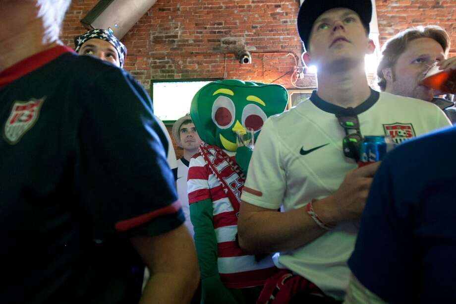Alec Hyvonen of Houston, TX, dressed up as Gumby, watches a World Cup qualifier game between Argentina and Ecuador at a pre-game party at Fuel Sports bar in Seattle. The fans were getting ready for the USA Men's National Team's World Cup Qualifier against Panama at Century Link Field in Seattle, WA on June 11, 2013.