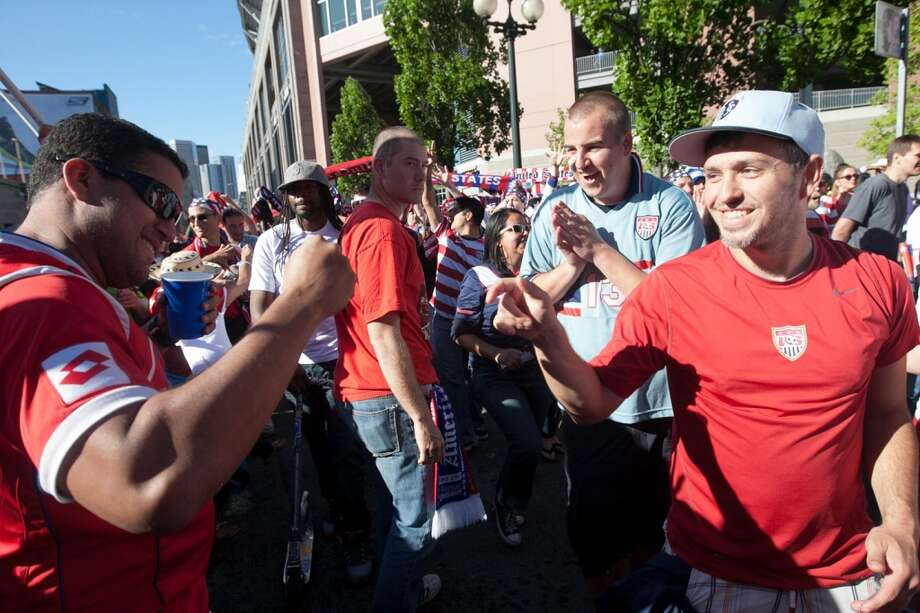Panamanian fan Alberto Lodiza (left) shakes hands with USA fan Dana Shoup of Kansas City, MO as the USA fans march outside Century Link Field before the USA Men's National Team's World Cup Qualifier against Panama in Seattle, WA on June 11, 2013.