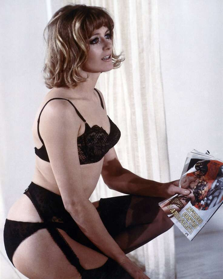 Vanessa Redgrave wearing black underwear and holding an Italian magazine, circa 1966. (Photo by Silver Screen Collection/Getty Images)