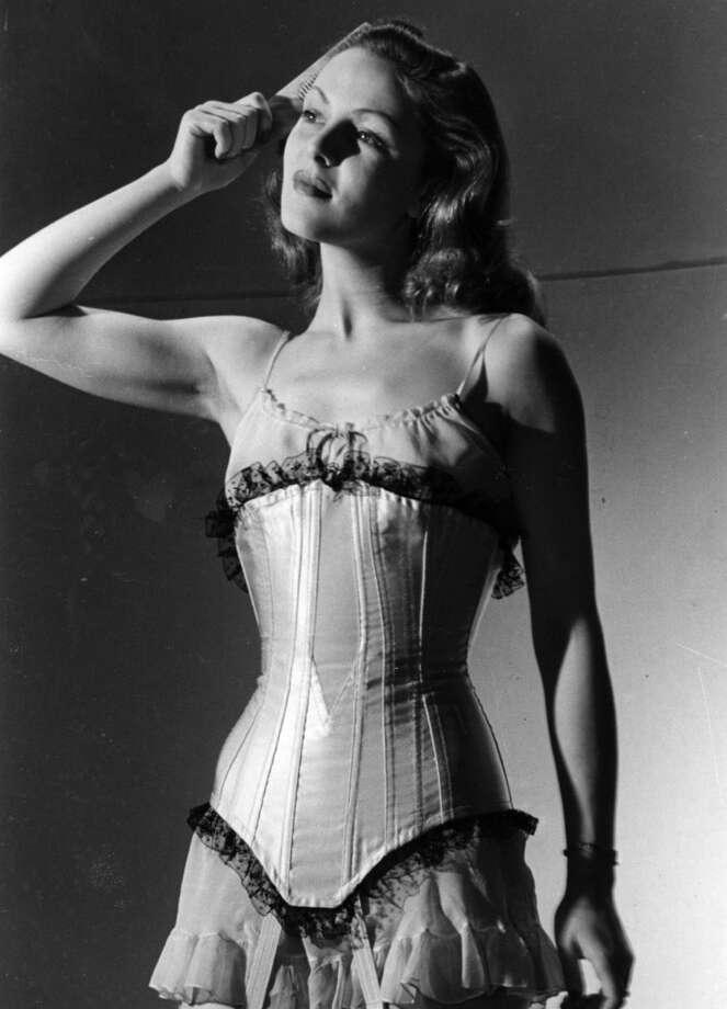 September 1945:  Film actress Hazel Court wearing a bustle.