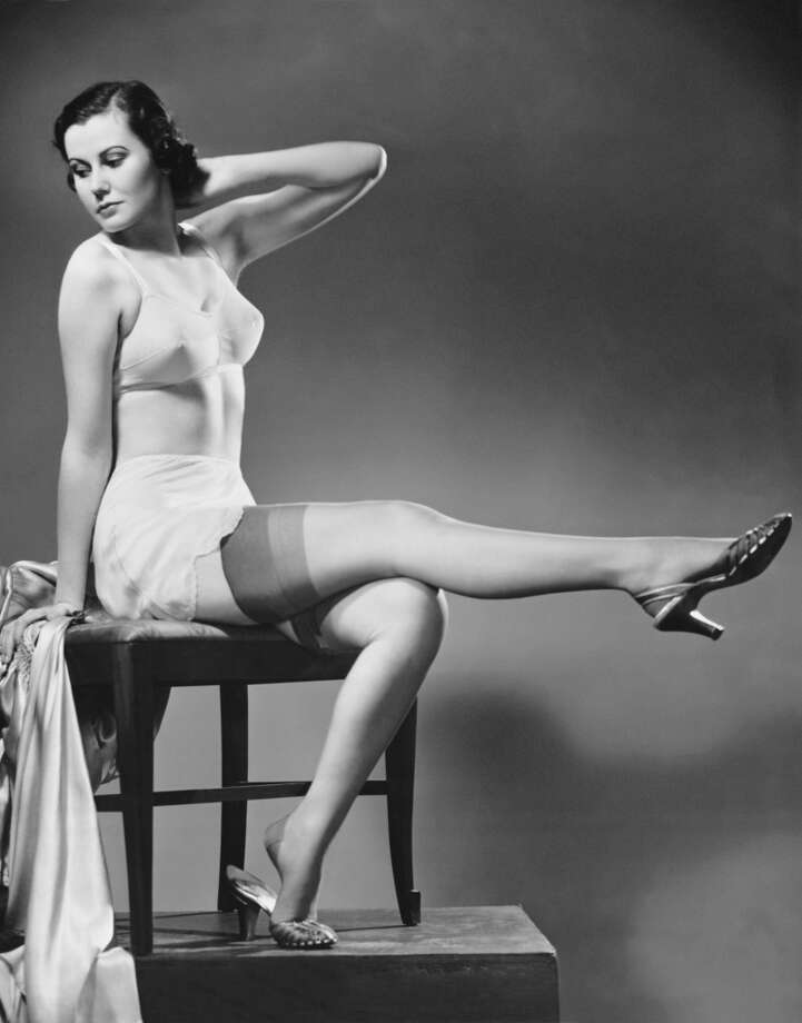 Circa 1950s:  Woman in undergarments.