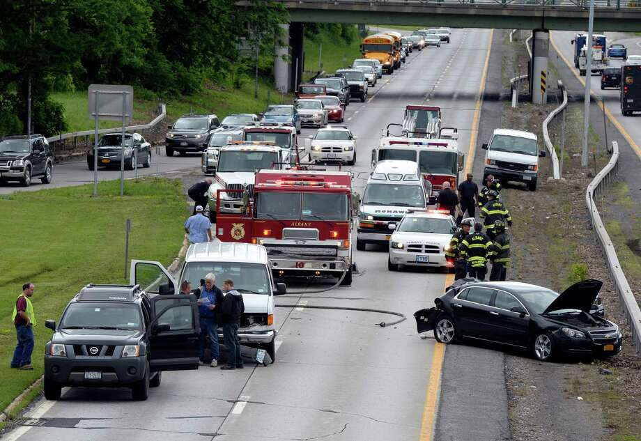 Albany Police and fire officials work at an accident scene on Route 85 in the northbound lane Wednesday morning June 12, 2013 in Albany, N.Y.    (Skip Dickstein/Times Union) Photo: SKIP DICKSTEIN