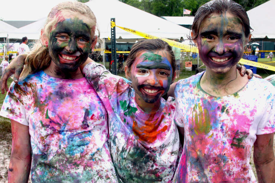'Paint the People'  Celebrating their very 'paintness' Saturday are, from left to right, Alyssa Biondino, Ella Rufa and Imre Mancini of New Milford. This trio and a reported thousands more were on hand during the Village Center for the Arts' second annual Paint the People event at Young's Field in New Milford. For the story and more photos, see the June 21 Spectrum and visit www.newmilfordspectrum.com. June 8, 2013 Photo: Walter Kidd