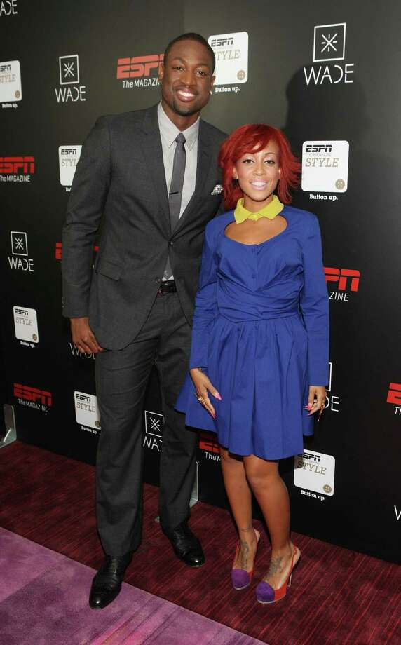 Dwyane Wade walks the red carpet with stylist Calyann Barnett at an event in New York. Photo: Bennett Raglin / WireImage