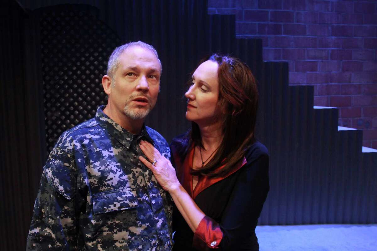 (For the Chronicle/Gary Fountain, June 4, 2013) Philip Lehl as MacBeth, and Kim Tobin as Lady MacBeth, in this scene from Stark Naked Theatre's production of Shakespeare's MacBeth.