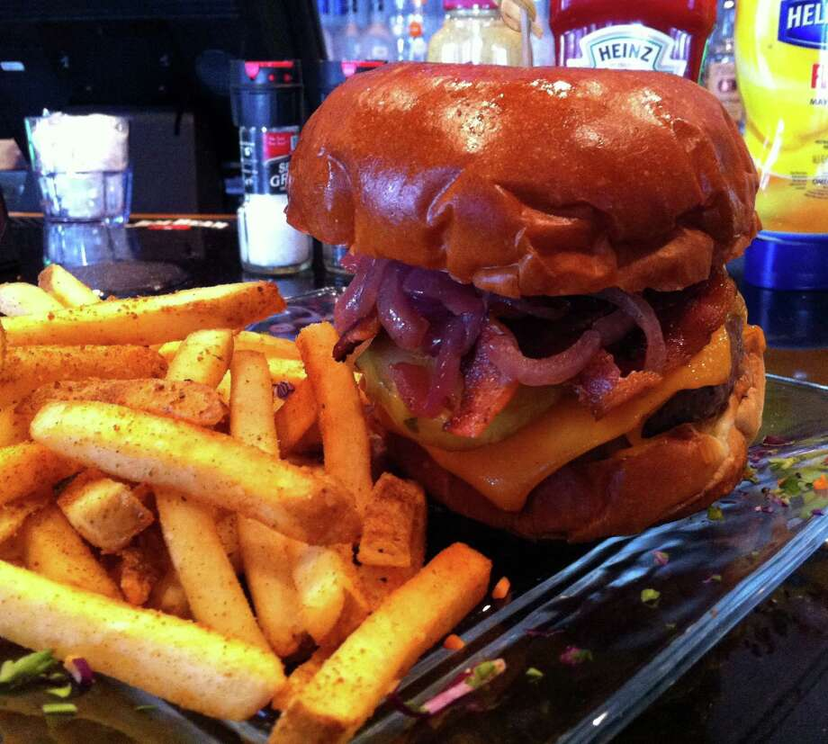The Chopping Block serves a variety of signature burgers, such as the Granny Smith ($12.25). Photo: Syd Kearney