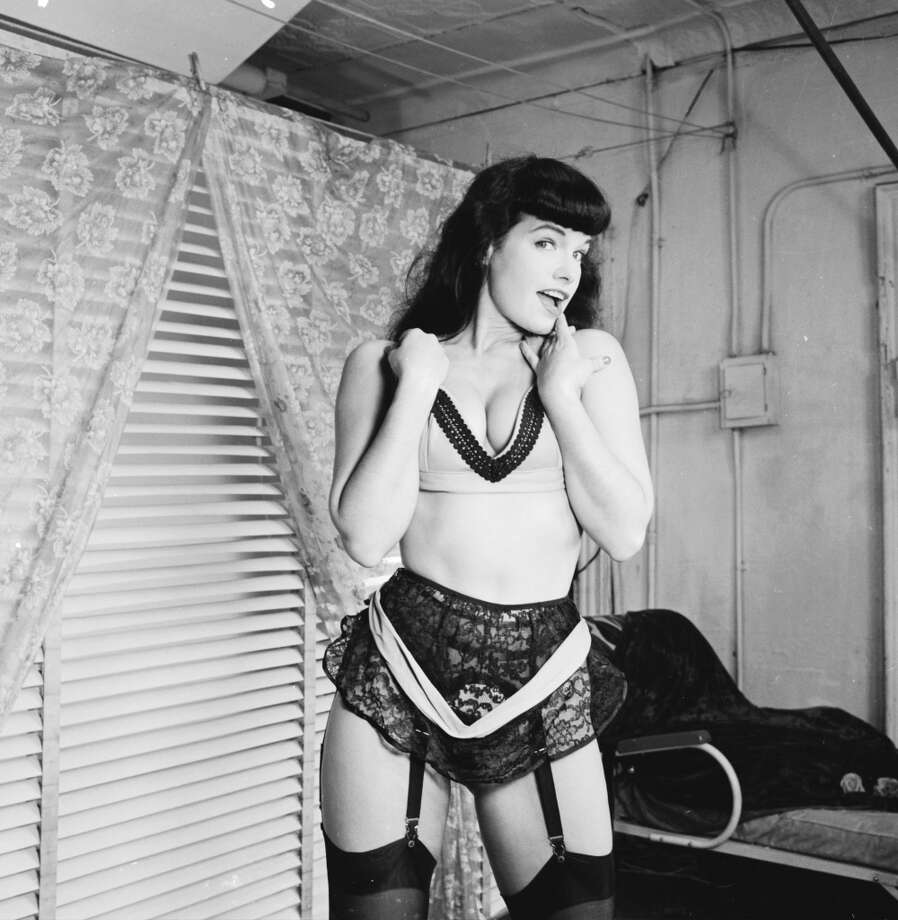 American pin-up Bettie Page, Playboy playmate of the month for January 1955, poses for a glamour shoot, 1950s.
