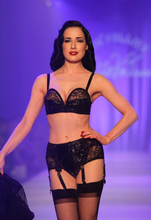 Dita Von Teese showcases designs by Von Folies by Dita Von Teese on the runway during L'Oreal Melbourne Fashion Festival on March 10, 2012 in Melbourne, Australia.  (Photo by Jennifer Polixenni Brankin/Getty Images)