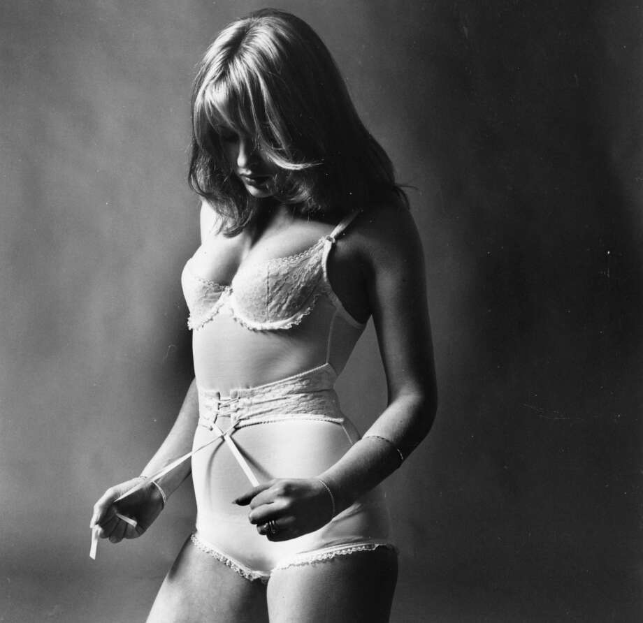 November 1970:  A woman models controlling underwear.