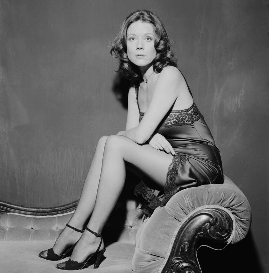 English actress Diana Rigg in a lacy slip and high heels, circa 1970. (Photo by Terry O'Neill/Hulton Archive/Getty Images)