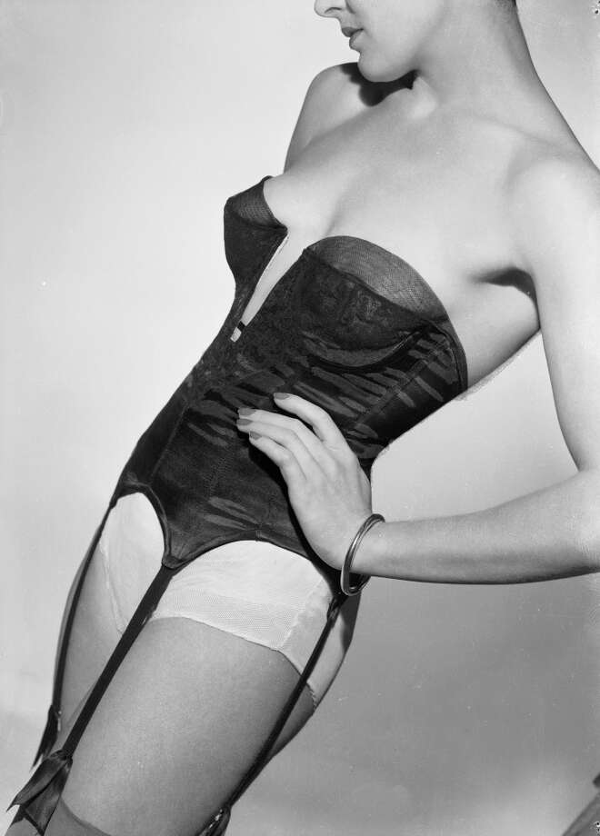 June 1949:  A strapless corset with suspenders attached.