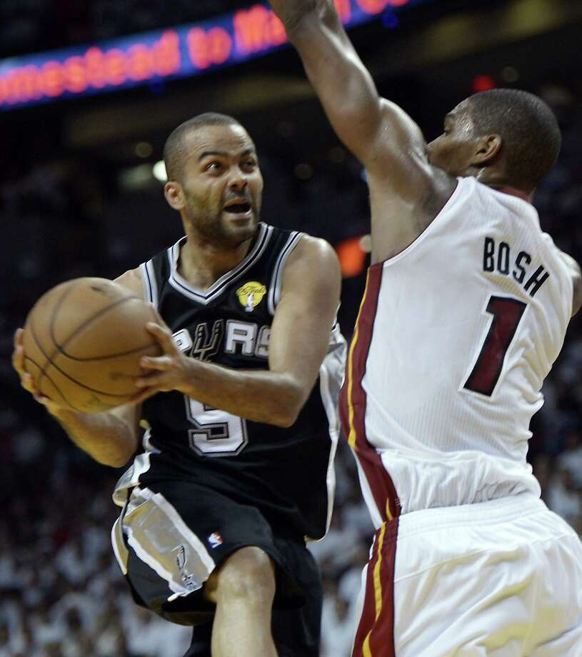 Tony Parker drives against Chris Bosh of the Miami Heat. Parker has blossomed into a team leader of the Spurs. Photo: BRENDAN SMIALOWSKI / AFP/Getty Images