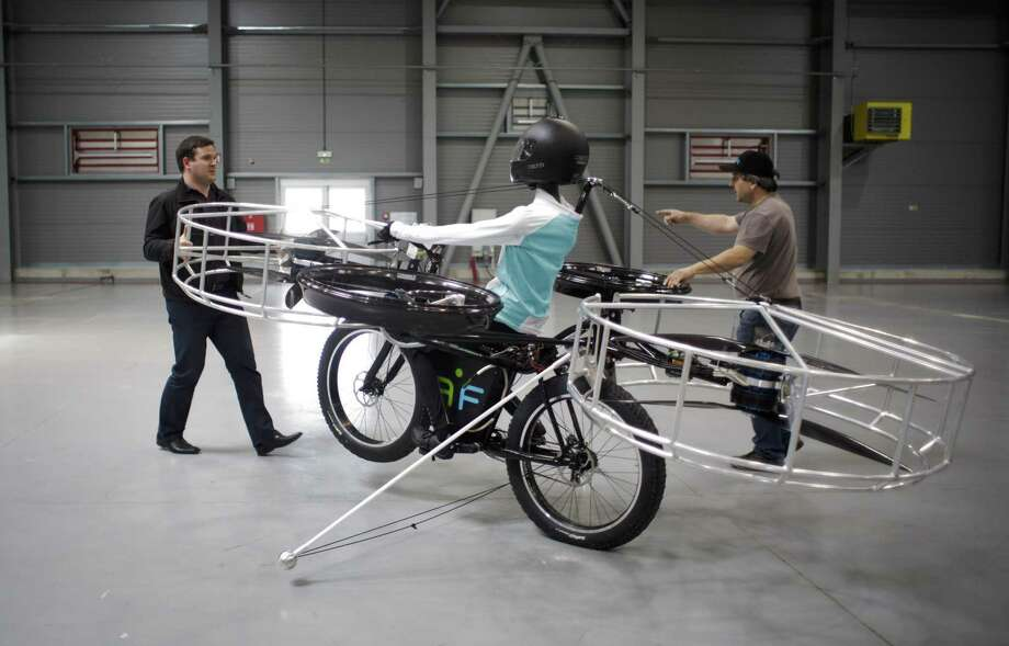 Technicians prepare a 'Flying bike' bicycle ahead of its first public flight on June 12, 2013 in Prague, Czech Republic. Photo: Matej Divizna, Getty Images / 2013 Matej Divizna