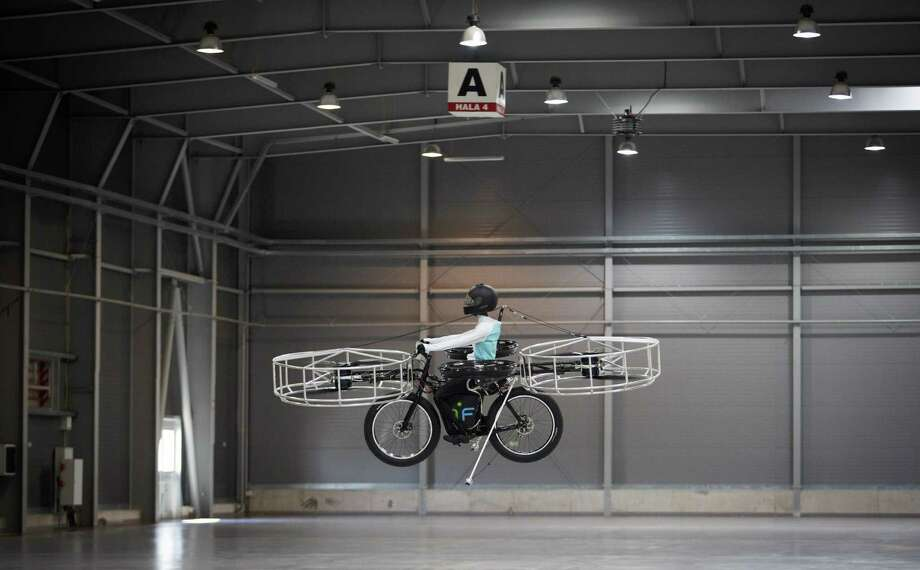 "A ""Flying bike"" carrying a dummy flies during its first public flight on June 12, 2013 in Prague, Czech Republic. Photo: Matej Divizna, Getty Images / 2013 Matej Divizna"