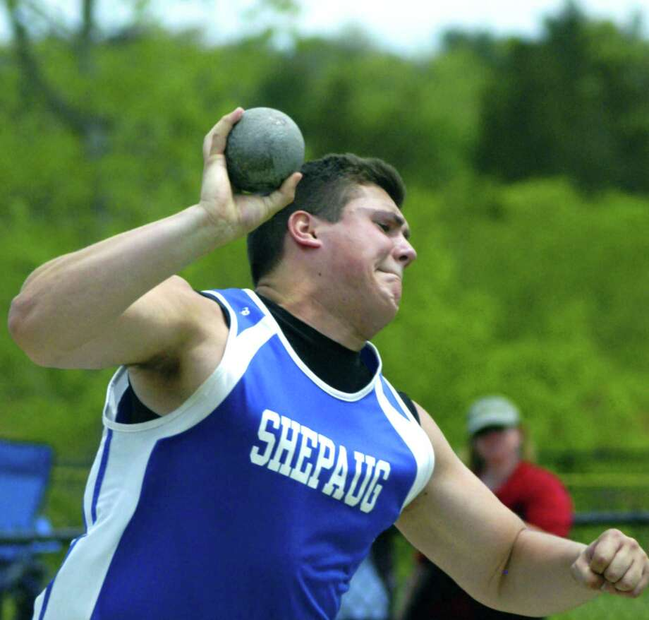 Peyton Kay of the Spartans competes en route to victory in the boys' shot put for Shepaug Valley High School boys' track in the May 18, 2013 Berkshire League championship meet at Litchfield High School. Peyton also registered a first place in the discus throw in his final Berkshire competition. Photo: Norm Cummings