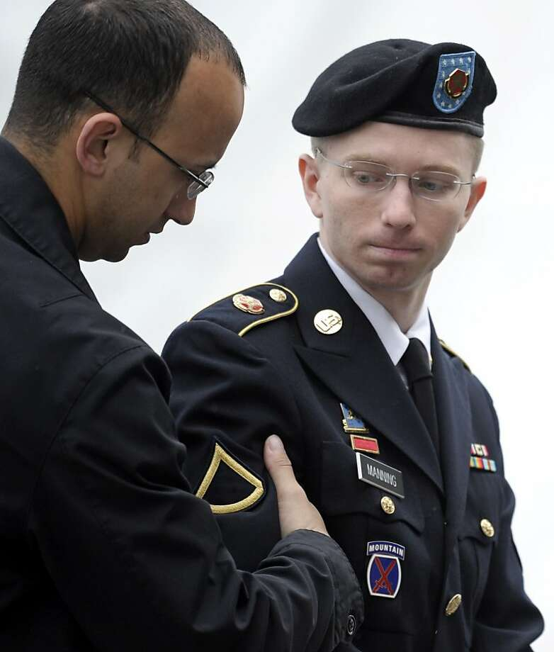 Pfc. Bradley Manning, left, has pleaded guilty to leaking. Photo: Cliff Owen, Associated Press