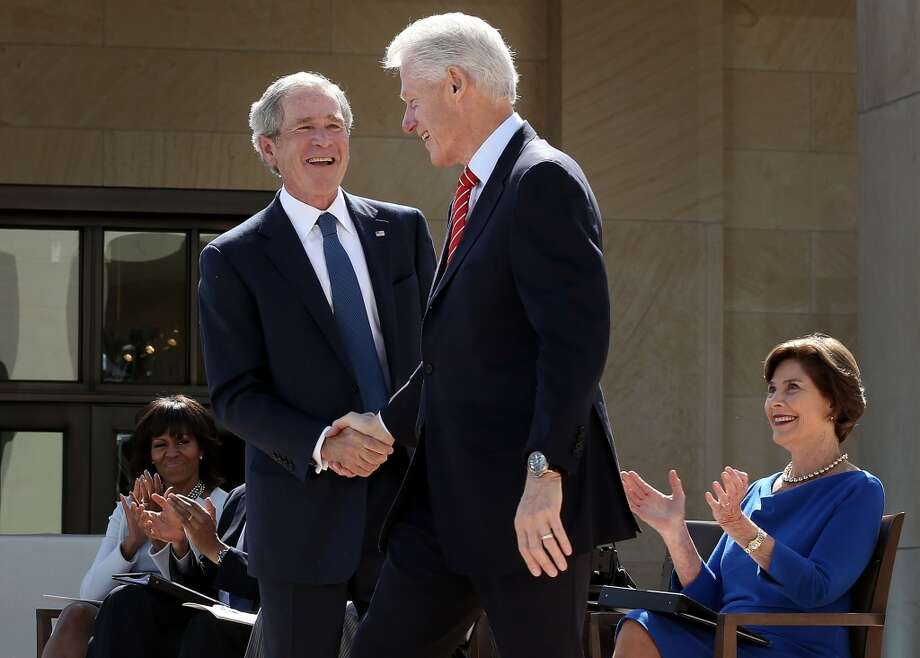 DALLAS, TX - APRIL 25:   Former U.S. President George W. Bush (2nd L) shakes hands with former President Bill Clinton (2nd R) as first lady Michelle Obama (L) and former first lady Laura Bush look on during the opening ceremony of the George W. Bush Presidential Center April 25, 2013 in Dallas, Texas. The Bush library, which is located on the campus of Southern Methodist University, with more than 70 million pages of paper records, 43,000 artifacts, 200 million emails and four million digital photographs, will be opened to the public on May 1, 2013. The library is the 13th presidential library in the National Archives and Records Administration system.  (Photo by Alex Wong/Getty Images)