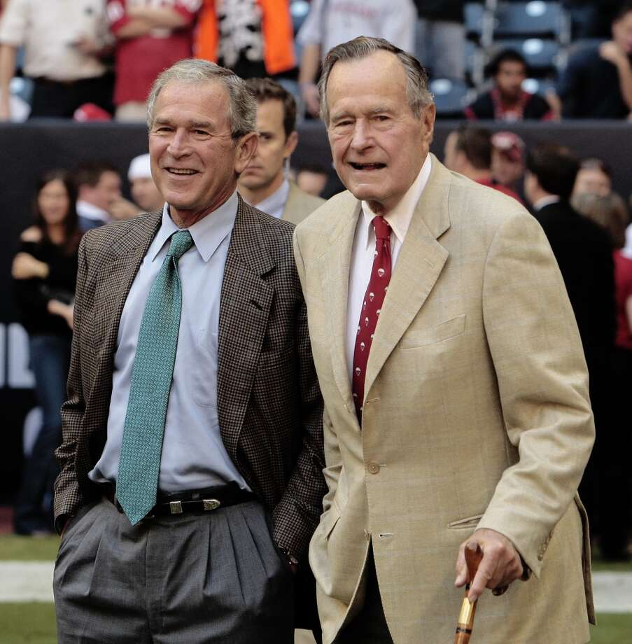 FILE - NOVEMBER 29: Former U.S. President George H.W. Bush has been hospitalized with bronchitis in Houston, Texas for six days, his spokesman said on November 29, 2012. HOUSTON - OCTOBER 25:  (L-R) Former US Presidents' George W. Bush and George H.W. Bush walk the sidelines before the game between the San Francisco 49ers and Houston Texans at Reliant Stadium on October 25, 2009 in Houston, Texas.  (Photo by Bob Levey/Getty Images)