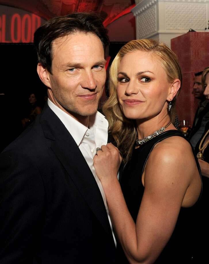 "Actors Stephen Moyer (L) and Anna Paquin pose at the after party for the premiere of HBO's ""True Blood"" at the Social Club on June 11, 2013 in Los Angeles, California.  (Photo by Kevin Winter/Getty Images)"