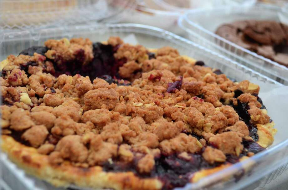 The raspberry rhubarb pie from the Whistle Stop Bakery was just one of many pies available to sample at the Darien Farmer's Market on June 12. Photo: Megan Spicer