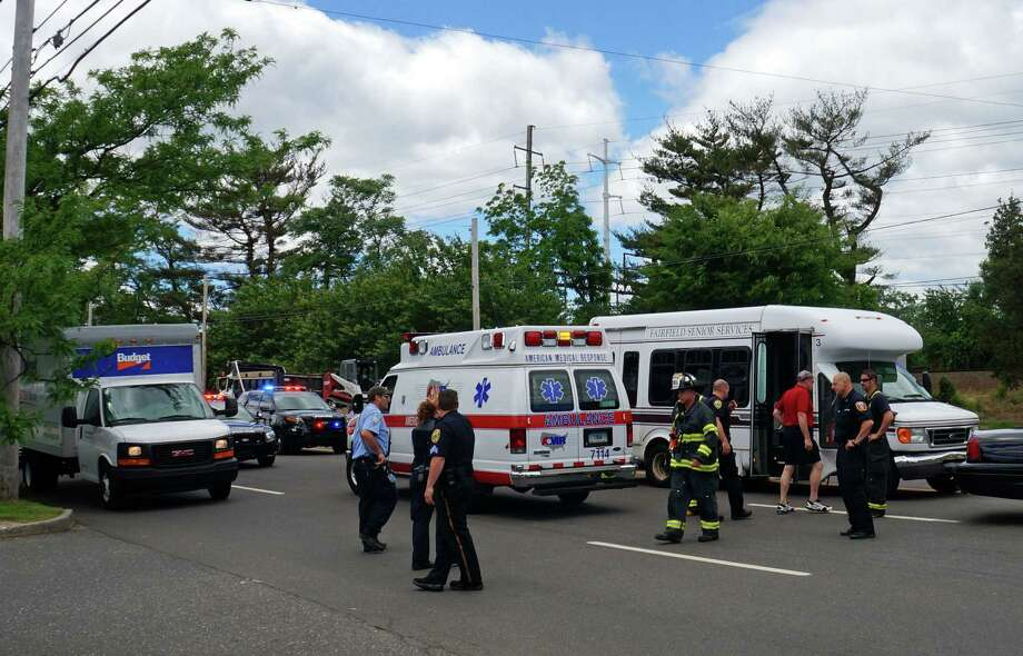A Senior Center bus, with four passengers aboard, collided with a car pulling out of the Bob's parking lot on the Post Road Wednesday afternoon. Photo: Genevieve Reilly / Fairfield Citizen