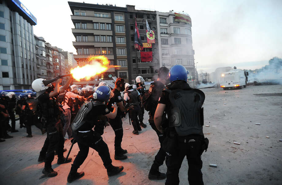 Turkish police firing tear gas battle anti-government protestors as they try to reestablish police control of Taksim Square after an absence of 10 days on June 11, 2013 in Istanbul, Turkey. The protest began over the Gezi Park redevelopment project but swiftly turned into a protest and street party aimed at Prime Minister Recep Tayyip Erdogan and what protestors call his increasingly authoritarian rule. The protest has spread to dozens of cities in Turkey, in secular anger against  Mr. Erdogan and his Islam-rooted Justice and Development Party (AKP). Photo: Scott Peterson, Getty Images / 2013 Scott Peterson