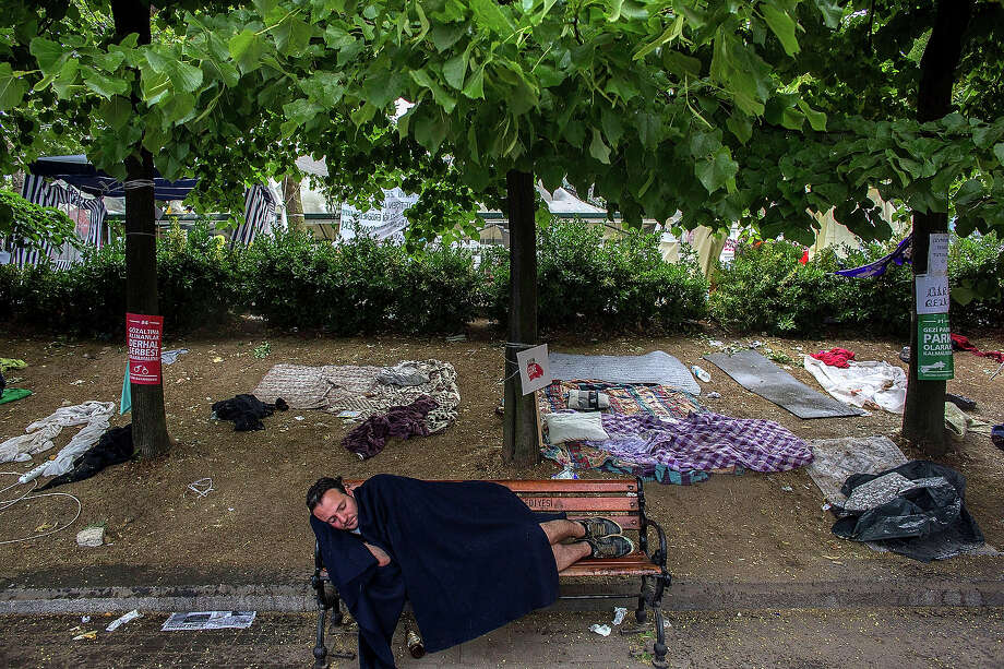 A man sleeps on a chair in Gazi Park the morning after a police crackdown on protesters, on June 12, 2013 in Istanbul, Turkey. Istanbul has seen protests rage on for days, with two protesters and one police officer killed. What began as a protest over the fate of Taksim Gezi Park, has turned into a wider demonstration over Prime Minister Recep Tayyip Erdogan's policies. Photo: Lam Yik Fei, Getty Images / 2013 Lam Yik Fei