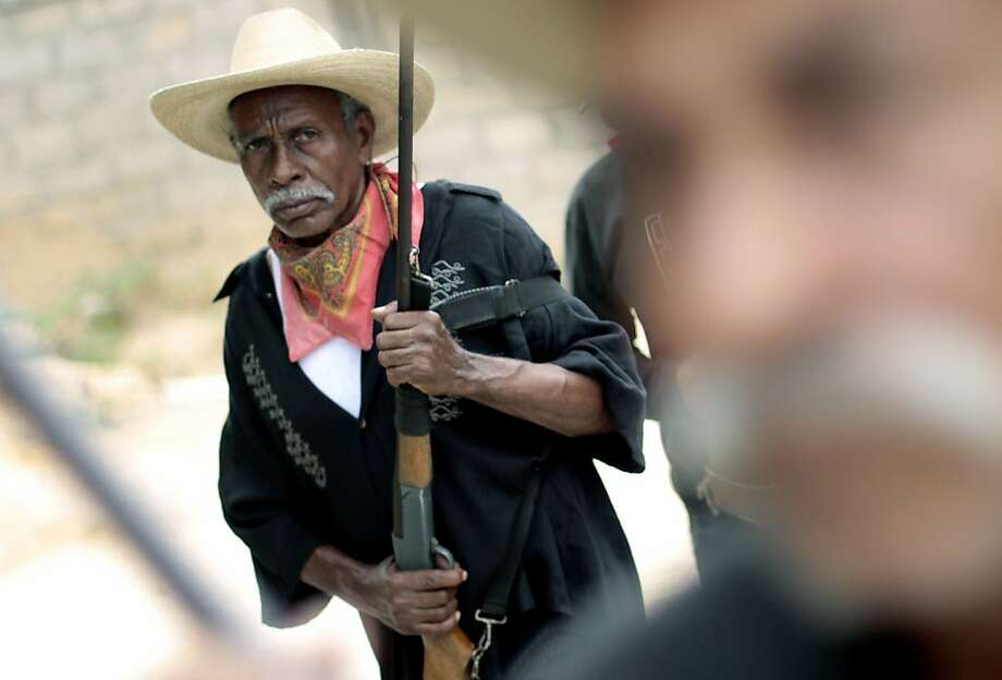 Armed residents provide security in Guerrero, Mexico. Photo: Pedro Pardo, AFP/Getty Images