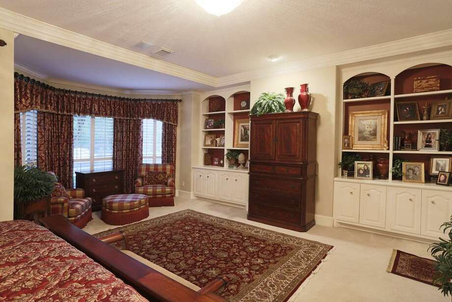 Master suite sitting area and built in display shelves with storage below. Photo: HAR