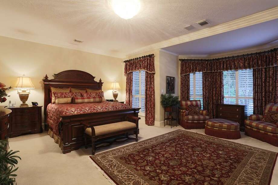 Master bedroom retreat with sitting area, plantation shutters and great views. Photo: HAR