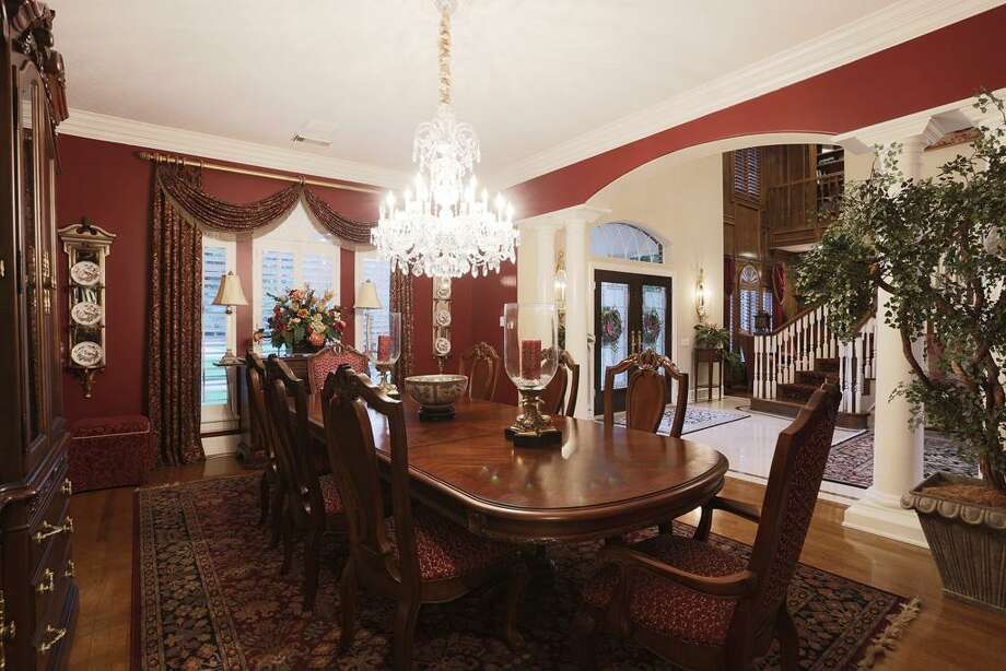 Spacious formal dining room with comfortable seating for 8+, wall space for art work or buffet and access to the butlers pantry Photo: HAR