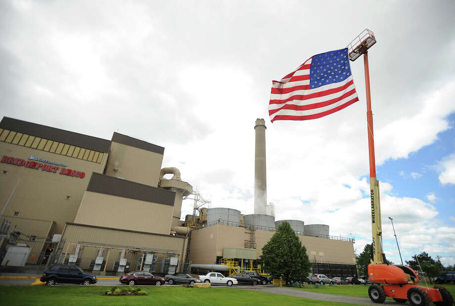 A giant American flag flies outside Wheelabrator's Bridgeport Resco waste-to-energy plant in celebration of the plant's 25th year in operation in Bridgeport, Conn. on Wednesday, June 12, 2013. Photo: Brian A. Pounds / Connecticut Post