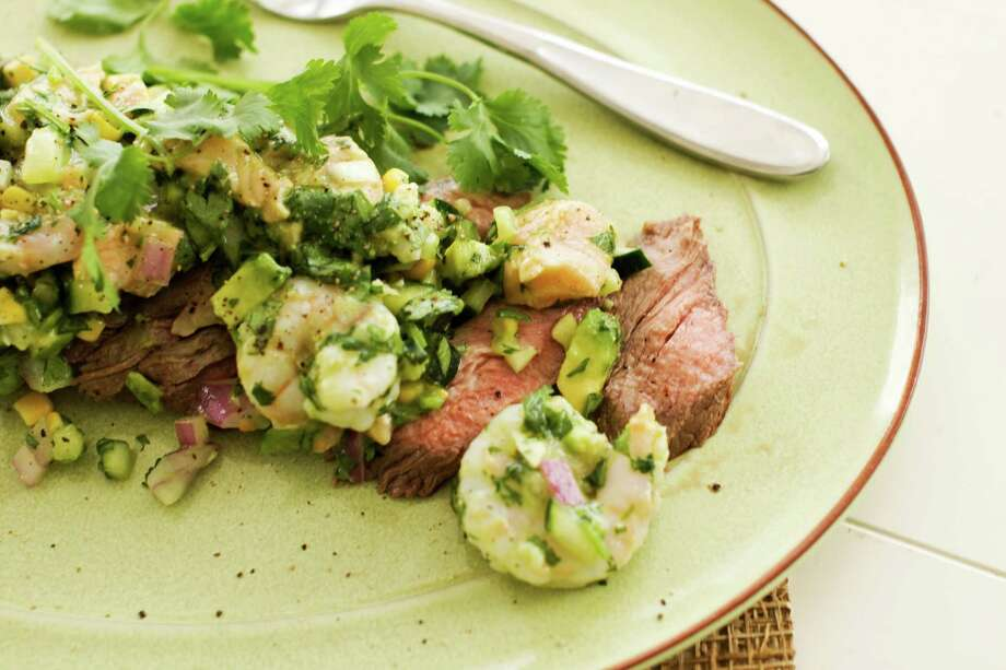In this image taken on May 13, 2013, a recipe for pepper-lime flank steak with shrimp and salmon ceviche is displayed in Concord, N.H. (AP Photo/Matthew Mead) Photo: Matthew Mead / FR170582