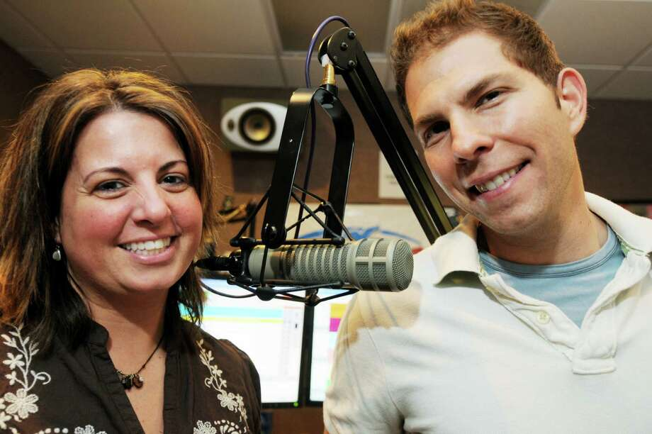 "Chrissy Cavotta, left, and Brian Cody, right, of the ""Fly Morning Rush"" 92.3 FM, Morning Drive radio show, were voted Best radio personalities by Times Union readers in the Best Of pole.  The morning duo who have worked together for almost four years are in their studio at Albany Broadcasting in Latham, NY, on Tuesday, May 18, 2010.   Photos for 2010 Times Union Best Of...        (Luanne M. Ferris/Times Union) Photo: LUANNE M. FERRIS"