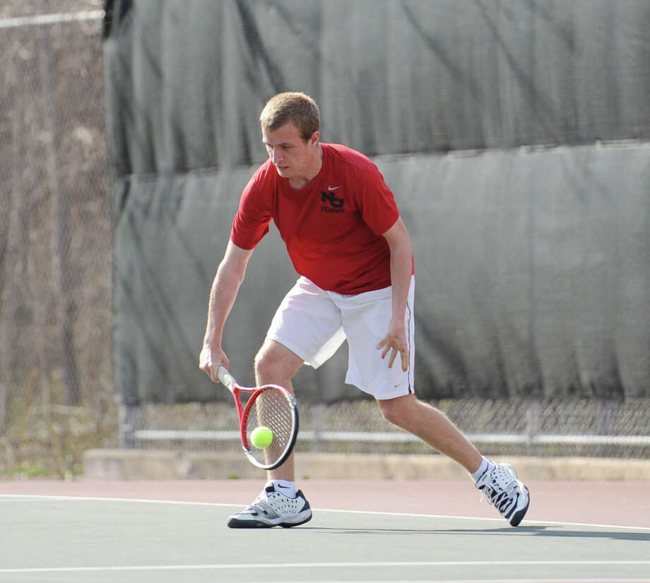 Will Burger of New Canaan hits during his match against Blake Niehaus of Greenwich in the boys high school tennis match between Greenwich High School and New Canaan High School at Greenwich, Tuesday, April 9, 2013. Greenwich won the match, 7-0. Photo: Bob Luckey / Greenwich Time