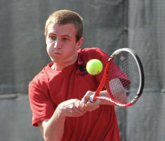 Will Burger of New Canaan hits during his match against Blake Niehaus of Greenwich in the boys high