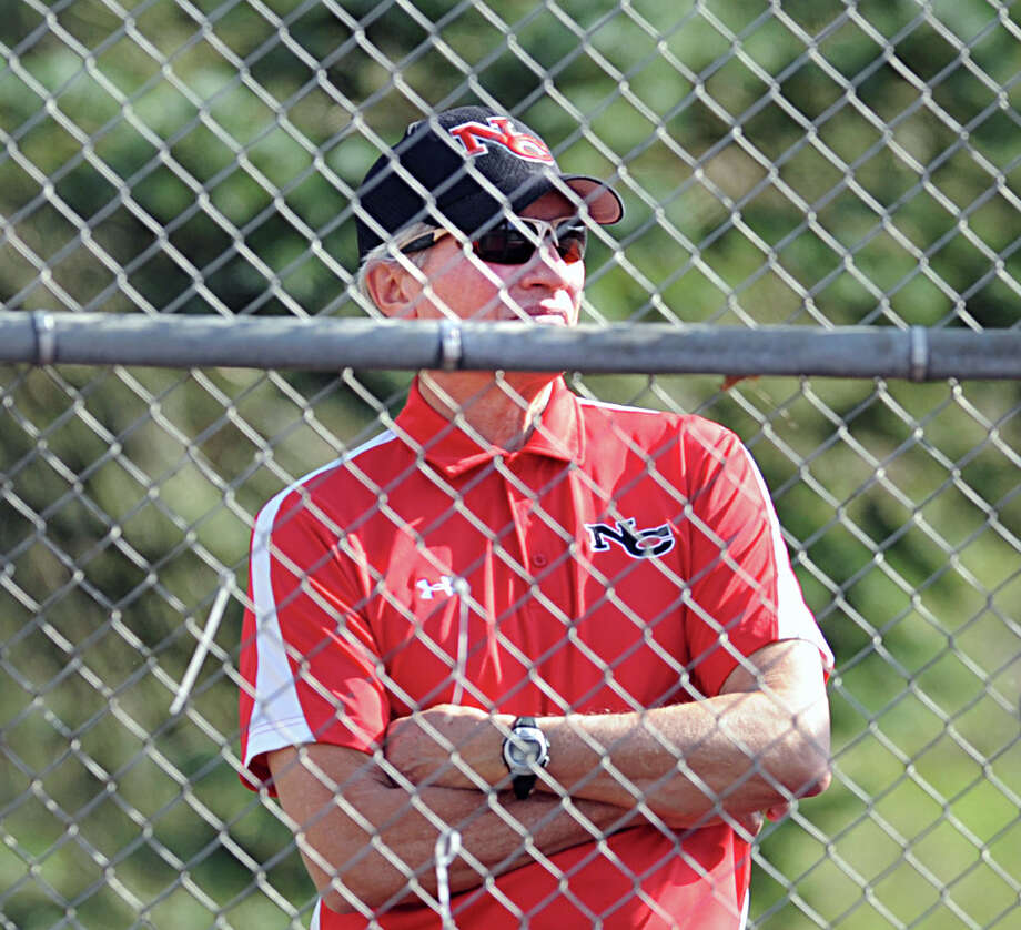 New Canaan boys tennis coach Dan Borgman during the boys high school tennis match between Greenwich High School and New Canaan High School at Greenwich, Tuesday, April 9, 2013. Greenwich won the match, 7-0. Photo: Bob Luckey / Greenwich Time