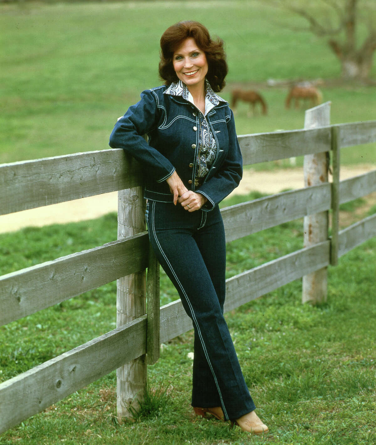 1970: Here is an exquisite example of a tailored Canadian tuxedo worn by country music icon Loretta Lynn. Rhinestones came into play in later years.