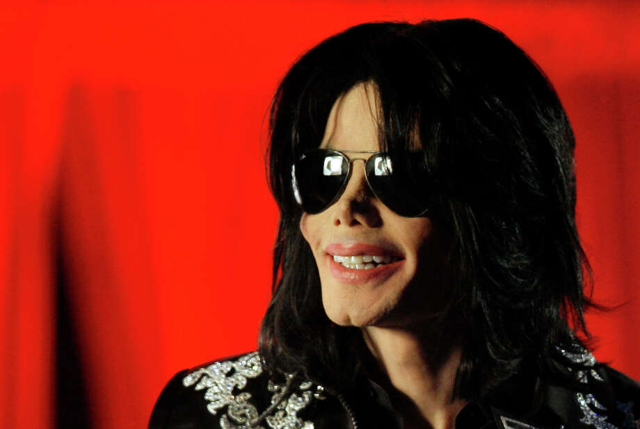 "FILE - In this March 5, 2009 file photo, Michael Jackson speaks at a news conference in London. AEG Live LLC CEO Randy Phillips told a jury Wednesday June 12, 2013 that they have heard an inaccurate portrait of Jackson during an ongoing civil trial, and said the entertainer was a sophisticated businessman and not a ""drug-addled 5-year-old."" The company and Phillips are being sued by Jackson's mother, claiming they did not properly investigate the doctor convicted of causing her son's death in 2009. (AP Photo/Joel Ryan, File) Photo: Joel Ryan"
