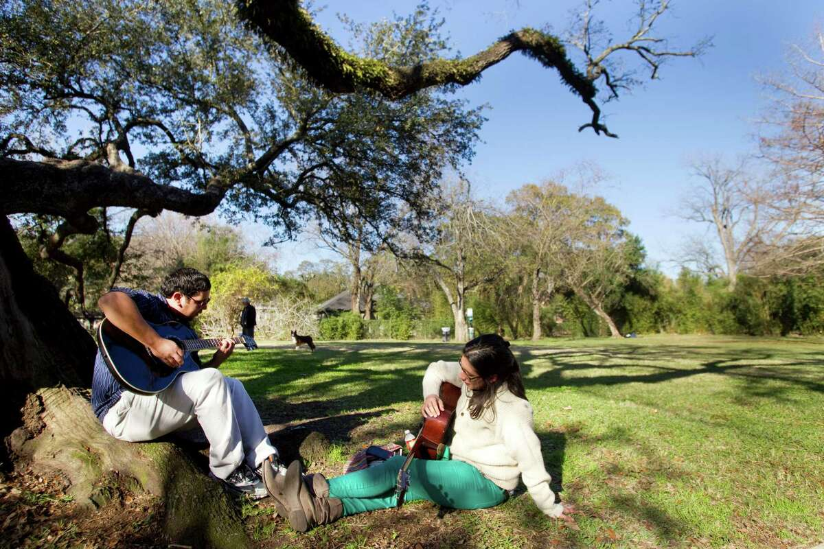 Michael Van Valkenburgh Associates' landscape plan for the Menil Collection's 30 acres of verdant grounds will preserve their low-key character. Rudy Villasana, left, and his cousin Jessica Villasana enjoyed the park space on a temperate day last January.