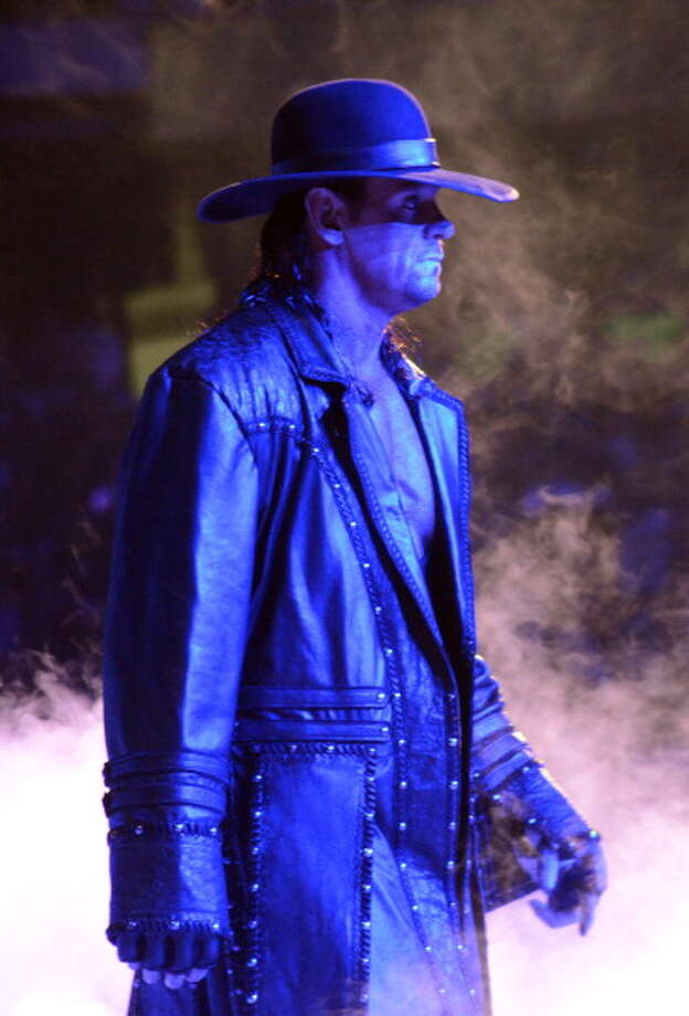 "PersonasCalaway's character has two alternate identities. The one most commonly associated with the Undertaker is ""The Deadman:"" a ghoulish, morbid priest-like figure. The second persona is the ""American Bad-Ass"" which emerged in the early 2000s. Calaway would dress up in outlaw motorcycle attire and drive to the ring on his motorcycle. Photo: Kevin Mazur, WireImage / WireImage"