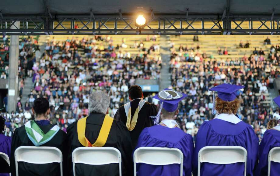Seattle City Councilman Bruce Harrell delivers the keynote  speech during the James A. Garfield High School commencement ceremony at Memorial Stadium on Tuesday, June 11, 2013.  Nearly 400 students graduated in the high school's 128th graduation ceremony.  Photo: LINDSEY WASSON, SEATTLEPI.COM / SEATTLEPI.COM