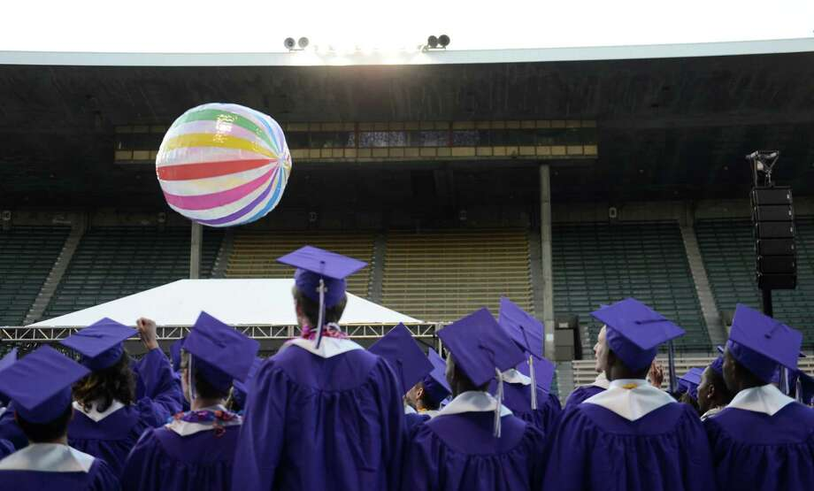 A large beach ball is passed around by seniors during the James A. Garfield High School commencement ceremony at Memorial Stadium on Tuesday, June 11, 2013.  Nearly 400 students graduated in the high school's 128th graduation ceremony. Photo: LINDSEY WASSON, SEATTLEPI.COM / SEATTLEPI.COM