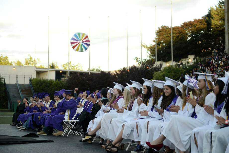 Seniors play with a beach ball during the James A. Garfield High School commencement ceremony at Memorial Stadium on Tuesday, June 11, 2013.  Nearly 400 students graduated in the high school's 128th graduation ceremony. Photo: LINDSEY WASSON, SEATTLEPI.COM / SEATTLEPI.COM