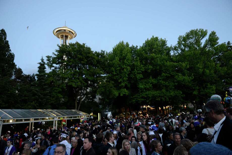 A swarm of family, friends and graduates gather outside near the International Fountain after the James A. Garfield High School commencement ceremony at Memorial Stadium on Tuesday, June 11, 2013.  Nearly 400 students graduated in the high school's 128th graduation ceremony.  Photo: LINDSEY WASSON, SEATTLEPI.COM / SEATTLEPI.COM