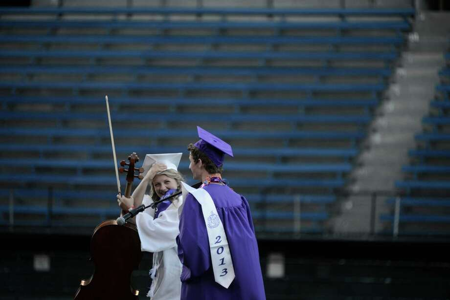 Taylor Jensen and Alexander Jones smile as they walk off the stage after performing The Star-Spangled Banner during the James A. Garfield High School commencement ceremony at Memorial Stadium on Tuesday, June 11, 2013.  Nearly 400 students graduated in the high school's 128th graduation ceremony.  Photo: LINDSEY WASSON, SEATTLEPI.COM / SEATTLEPI.COM