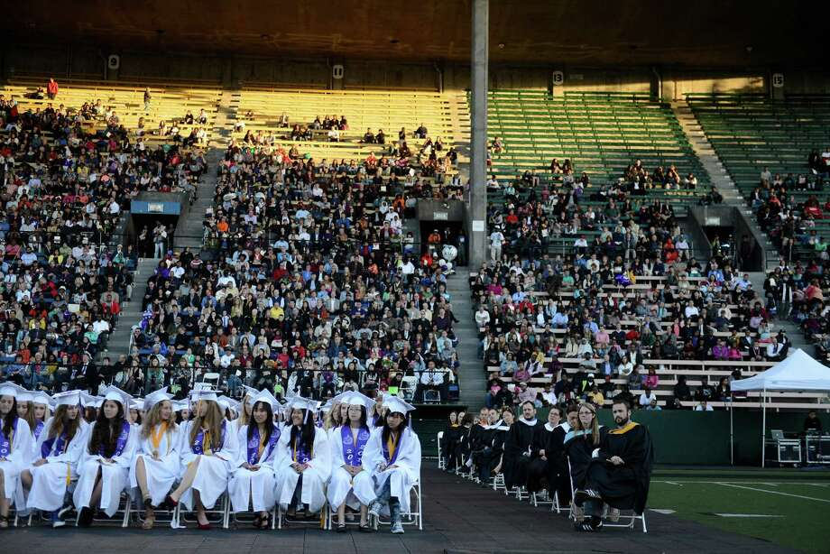 The audience listens to Bruce Harrell speak during the James A. Garfield High School commencement ceremony at Memorial Stadium on Tuesday, June 11, 2013.  Nearly 400 students graduated in the high school's 128th graduation ceremony.  Photo: LINDSEY WASSON, SEATTLEPI.COM / SEATTLEPI.COM