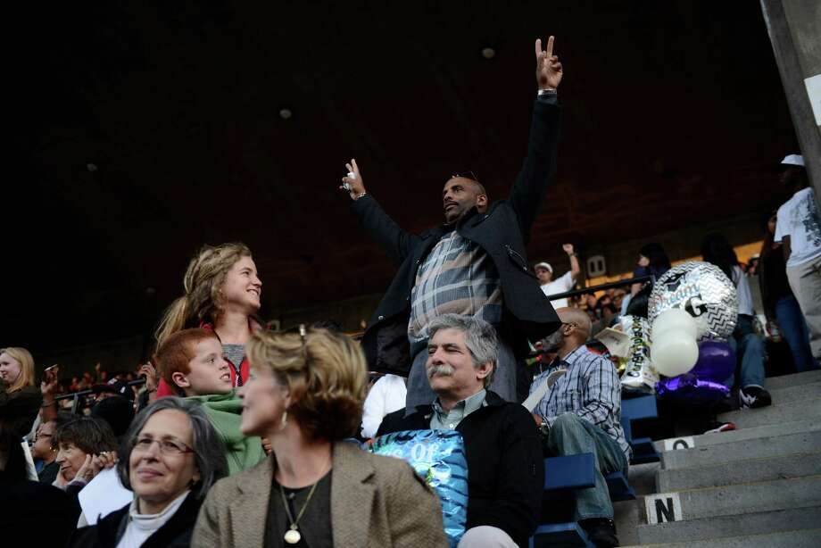 Parents who graduated from Garfield in the past stand up in support during the James A. Garfield High School commencement ceremony at Memorial Stadium on Tuesday, June 11, 2013.  Nearly 400 students graduated in the high school's 128th graduation ceremony.  Photo: LINDSEY WASSON, SEATTLEPI.COM / SEATTLEPI.COM