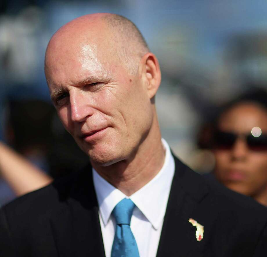 Florida Gov. Rick Scott speaks to the media during a visit to PortMiami on May 14, 2013 in Miami, Florida. The Republican governor sent 100 letters to Connecticut businesses encouraging them to move to the Sunshine State. Photo: Joe Raedle, Getty Images / 2013 Getty Images