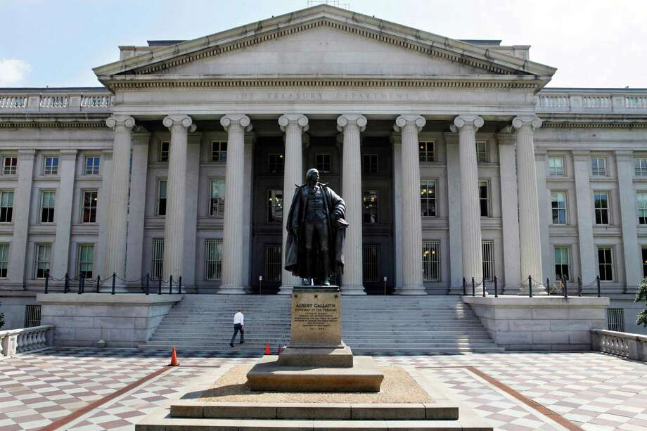 FILE - In this Monday, Aug. 8, 2011 file photo, a statue of former Treasury Secretary Albert Gallatin stands outside the Treasury Building in Washington. The Treasury reports on the federal budget deficit for May, on Wednesday, June 12, 2013. (AP Photo/Jacquelyn Martin, File) Photo: Jacquelyn Martin